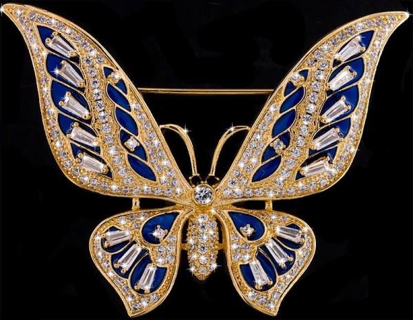Brosche Schmetterling goldfarben mit blauen Details und vielen weissen Strass Steinen BR056